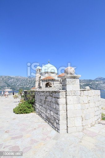 Perast, Montenegro - July 11, 2012: Our Lady of the Rock island and Church in Perast on shore of Boka Kotor bay, Montenegro