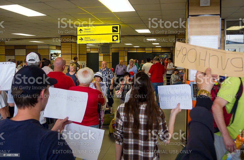 Our people expect the arriving passengers at the exit stock photo