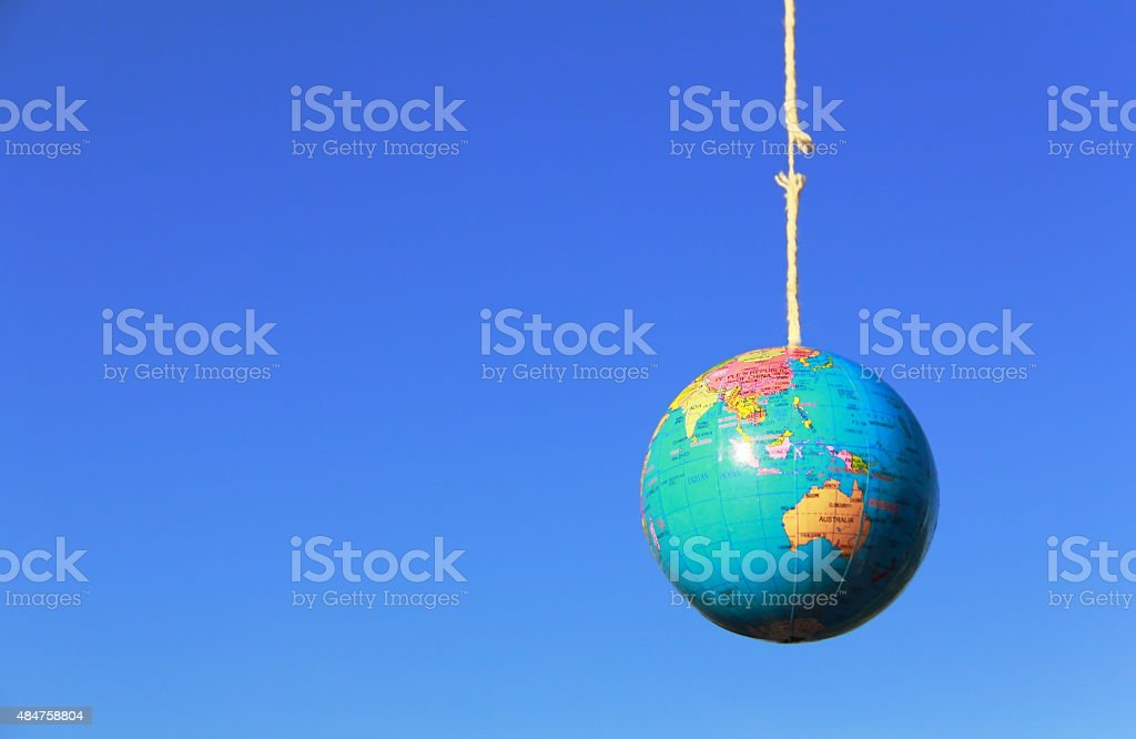 Our planet is hanging by a thread stock photo