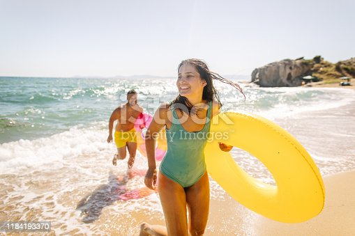 Photo of smiling couple at the beach