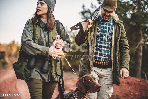 Men and women hunting in nature