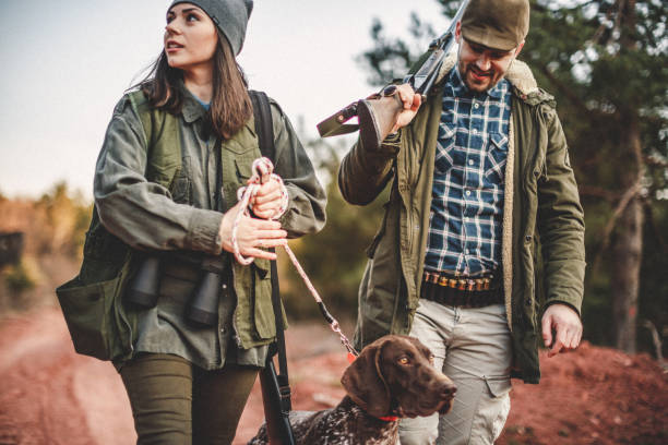 Our woods, our rools Men and women hunting in nature bird hunting stock pictures, royalty-free photos & images