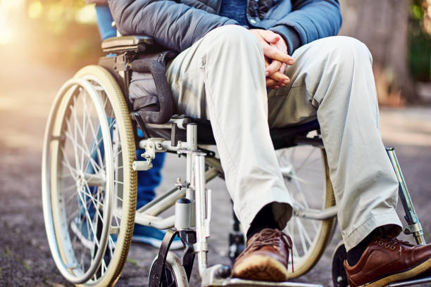 Out and about Cropped shot of an unrecognizable senior wheelchair-bound man sitting in the park paralysis stock pictures, royalty-free photos & images