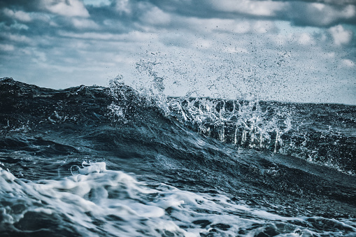 Out in a rough sea, waves crashing