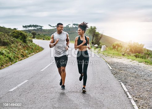 Shot of a sporty young couple exercising together outdoors