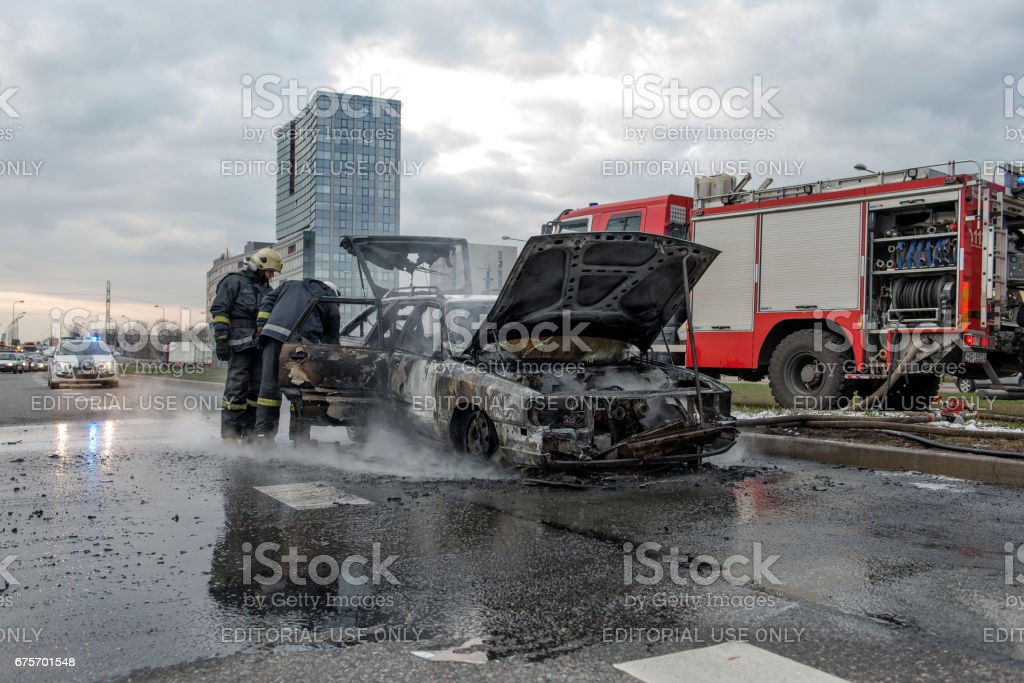 Out into the road stands just doused car. Firefighters inspected losses. Traffic is stopped. royalty-free stock photo