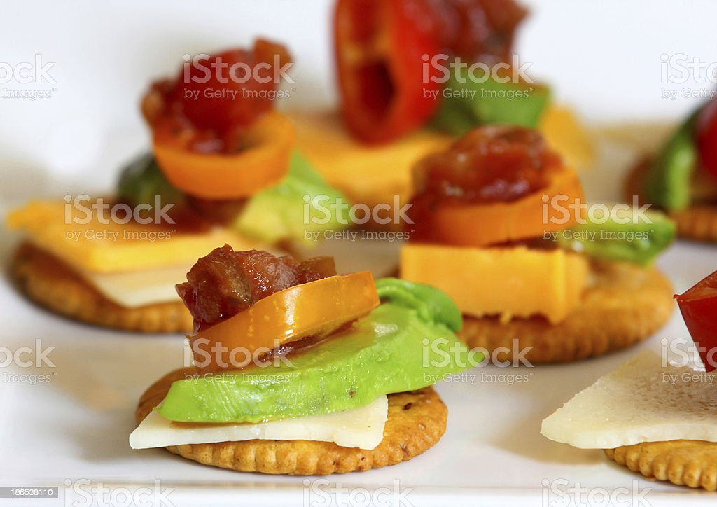Hors d'oeuveres on crackers. stock photo
