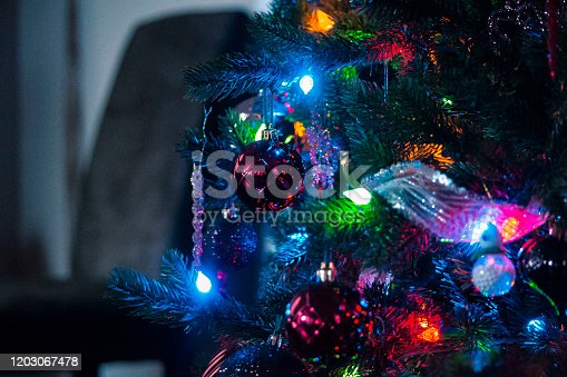 889246424 istock photo Out of focus Christmas lights 1203067478