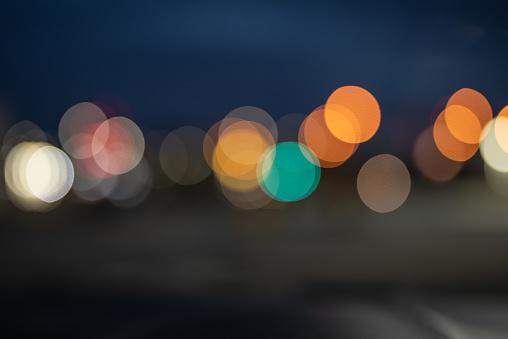 Blurred blue and orange city night lights of Puebla, Mexico