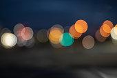 Abstract defocused bokeh background of night street lights