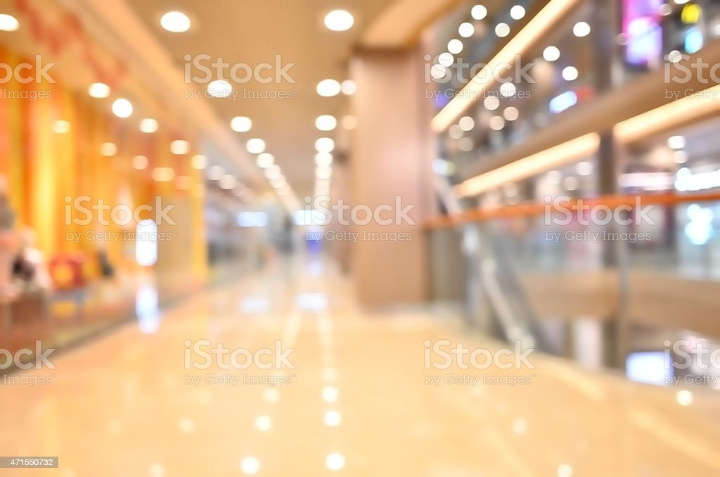 Out of focus interior of a shopping mall stock photo