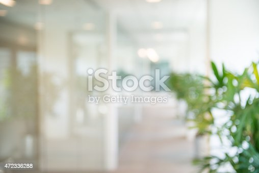 istock Out of focus Office Open Corridor Background 472336288