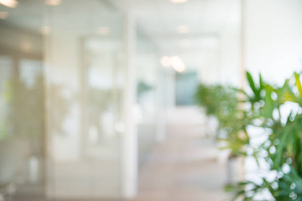 out of focus office open corridor background - motion stock pictures, royalty-free photos & images