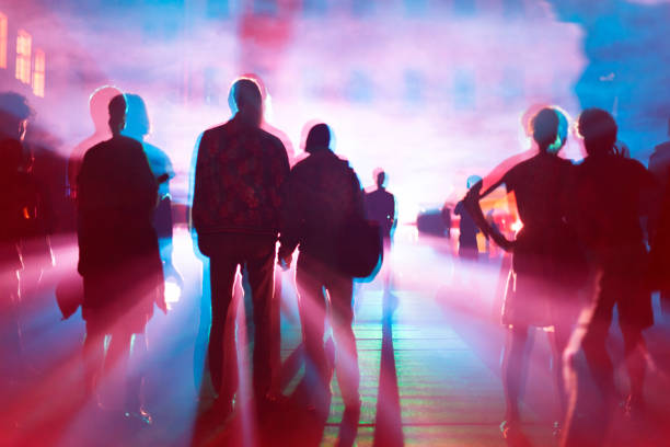 Out of focus Silhouettes of people - multible exposure in red and blue stock photo