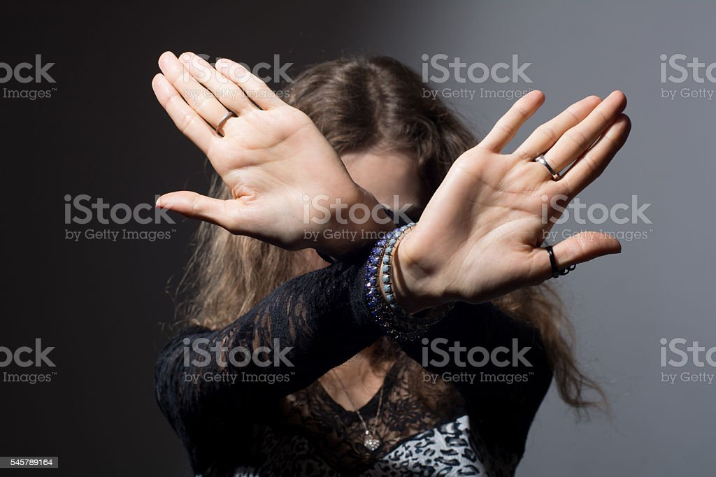 Out of focus woman with her hands signaling stock photo