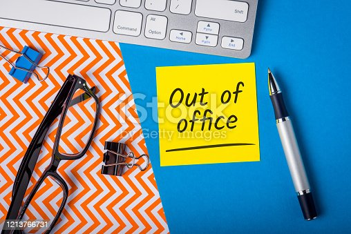istock Out of office - memo on office workplace. Holiday Announcement, Day Off or Quarantine Covid-19 1213766731