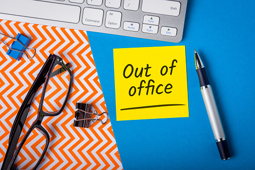 Out of office - memo on office workplace. Holiday Announcement, Day Off or Quarantine Covid-19.