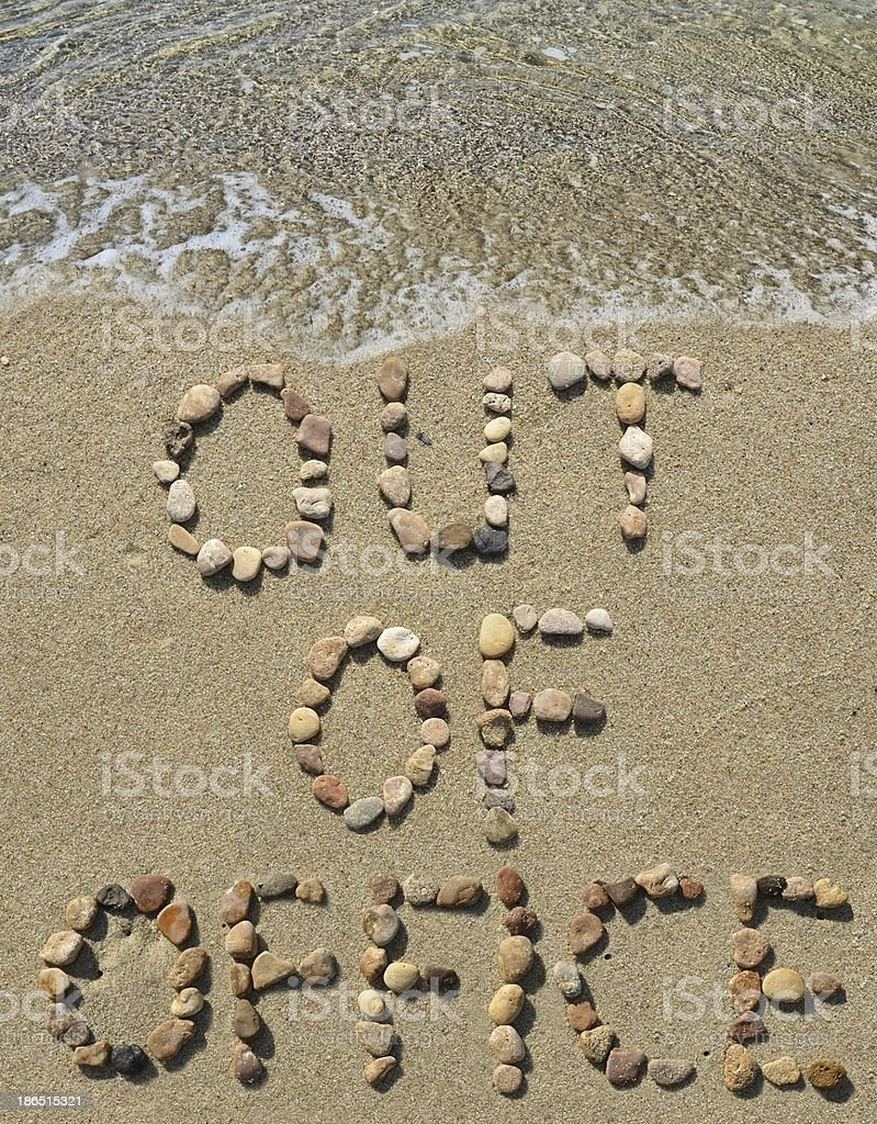 Out of office washed by waves royalty-free stock photo