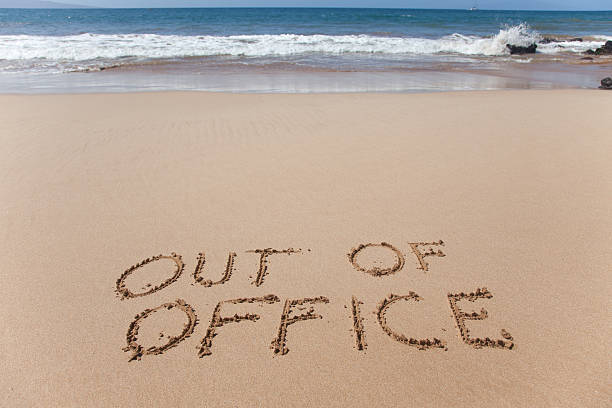 out of office written in the sand on a beach - after work stock photos and pictures