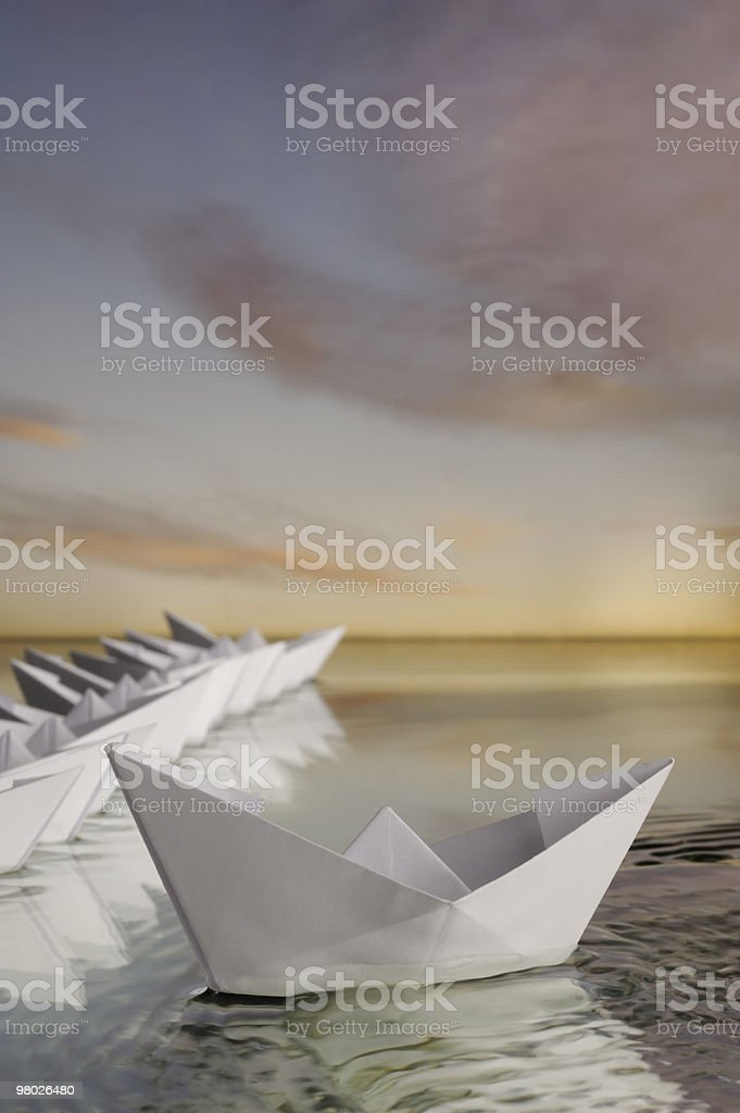 Out of the crowd paper boat royalty-free stock photo
