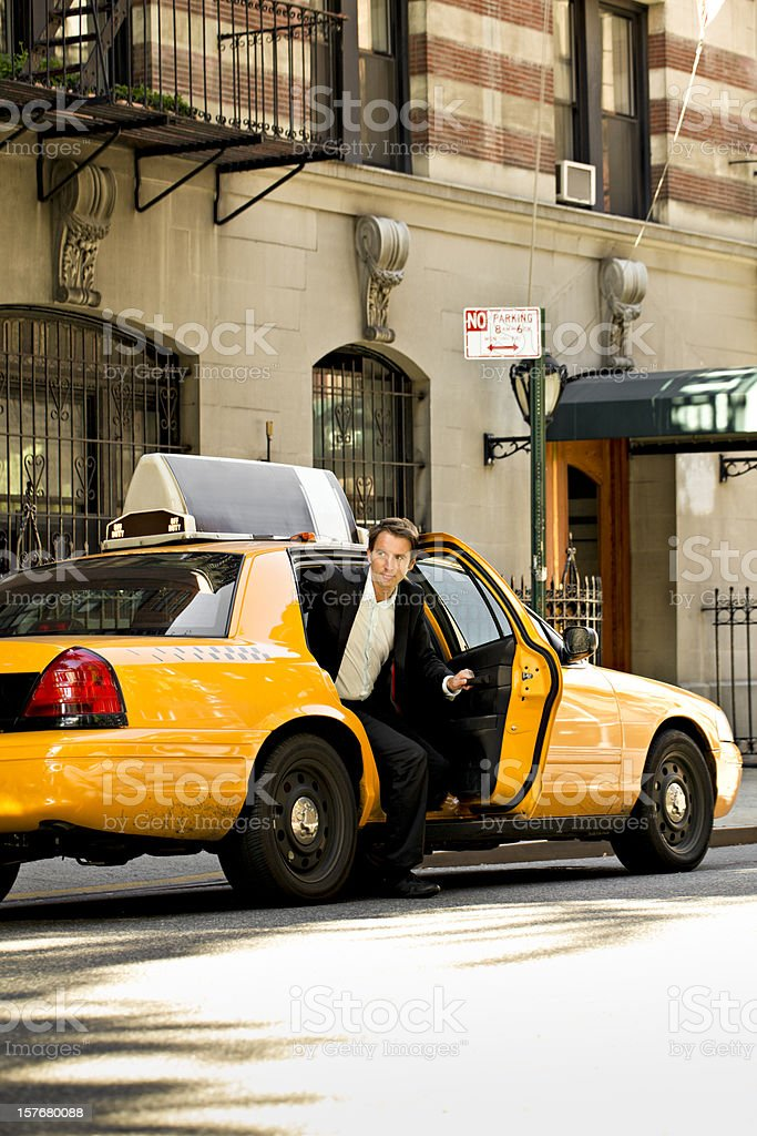 out of the yellow cab royalty-free stock photo