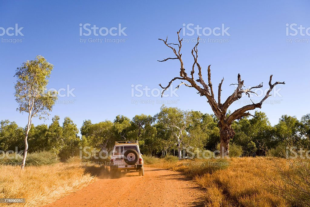 Outback Australia 4X4 Vehicle Driving on Red Gravel Road stock photo