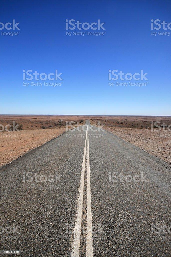 Outback Road Australia, Vanishing into the Desert royalty-free stock photo