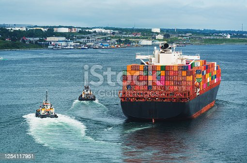 istock Outbound Container Ship 1254117951