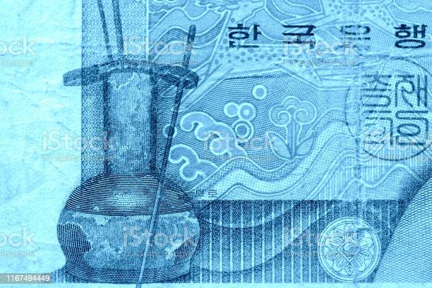 Outdated 1000 Korean Won note of 1983 issued close-up blue color toned
