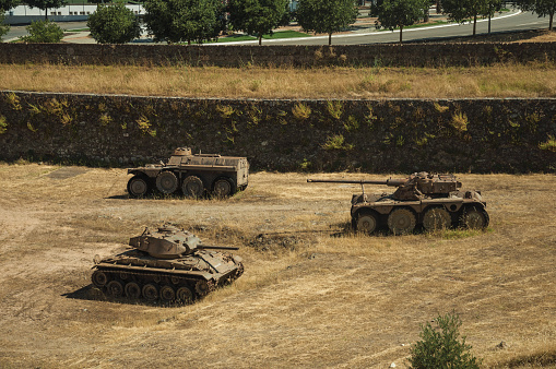 Outdated war tanks in the moat next to the wall of Elvas