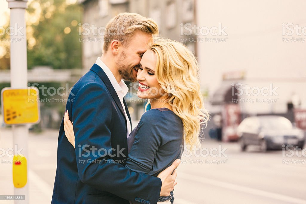 Outddor portrait of affectionate couple embracing stock photo