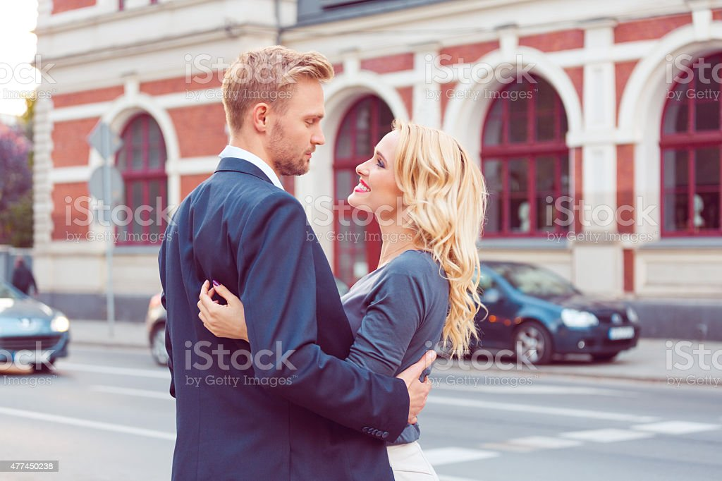 Outddor portrait of affectionate couple on a street stock photo