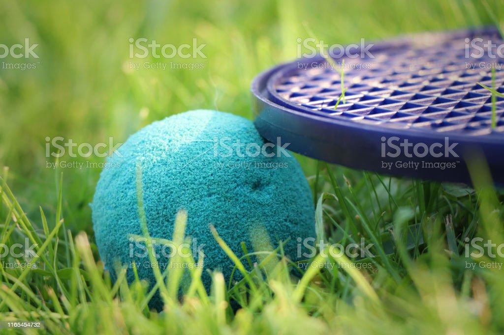 Outdoor activities. soft tennis green ball and soft racket lies in...