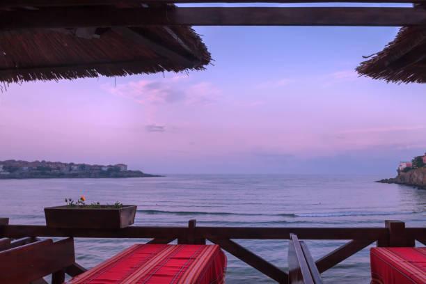 Outdoor alternate lodging with veranda on the sea coastline summer sunset nature stock photo