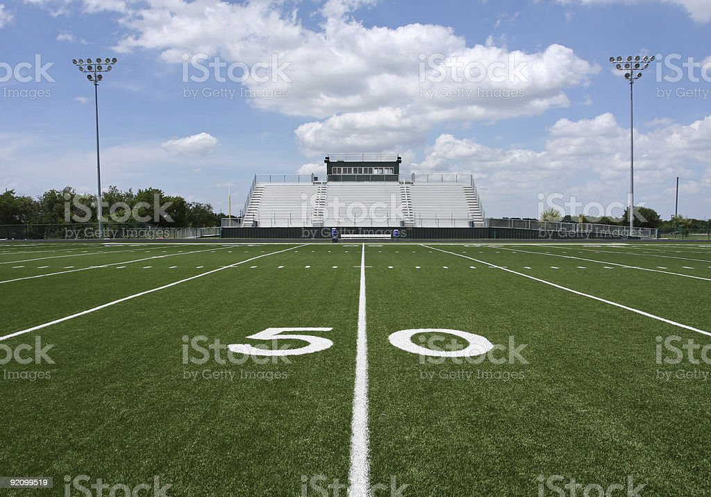 Outdoor American Football Stadium and Bleachers at 50 yard line stock photo