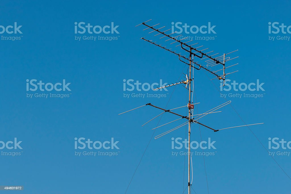 TV Outdoor Antenna Receiver on roof house stock photo