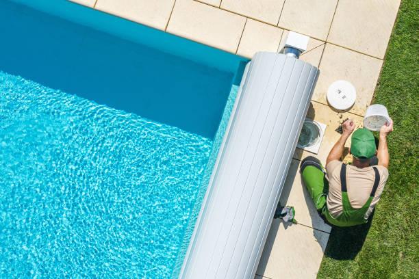 Outdoor Backyard Garden Swimming Pool Maintenance. stock photo