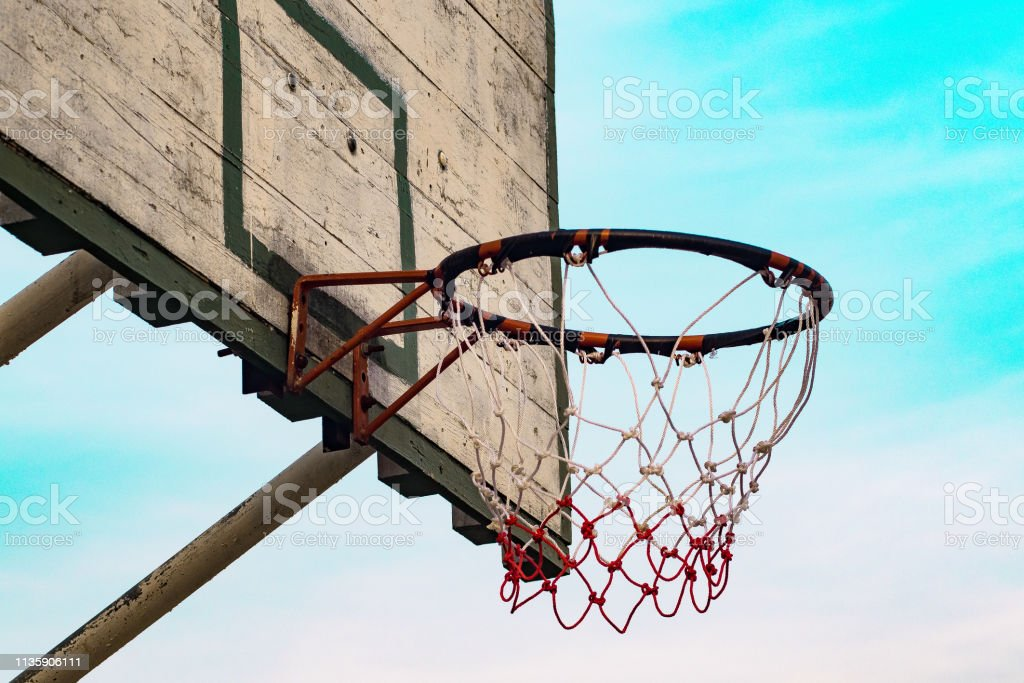 Outdoor basketball court at sunrise nature sky background healthy...