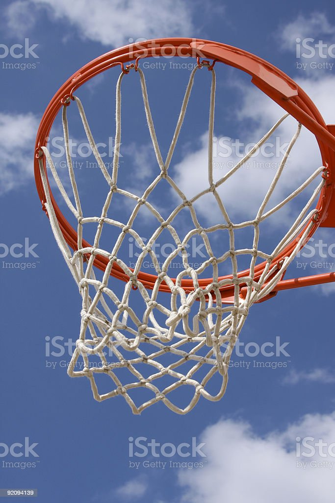 Outdoor Basketball Hoop against Cloudy Sky stock photo