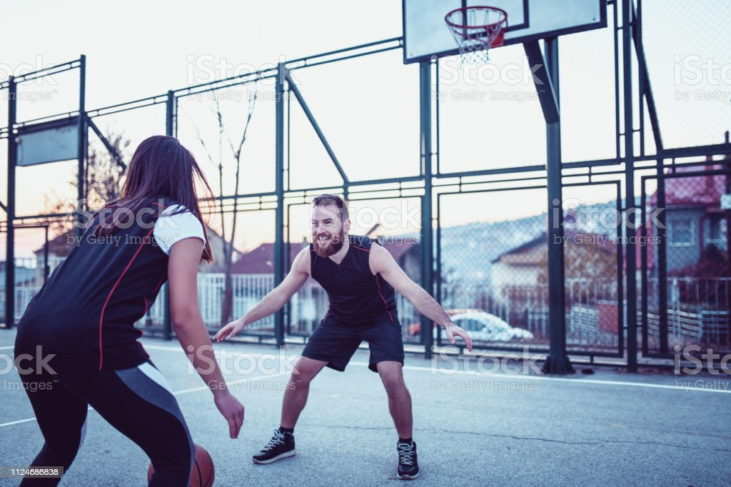 Female Basketball Player On Training With Her Male Instructor