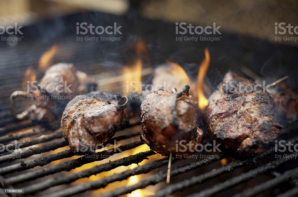 outdoor bbq grill venison steaks stock photo
