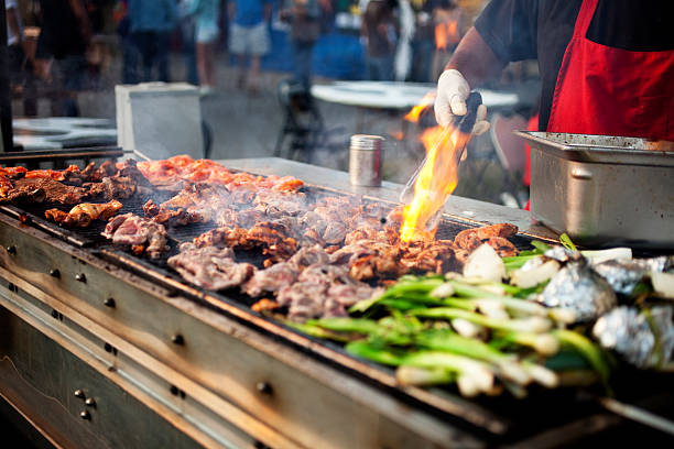 outdoor bbq grill w/flame - traditional festival stock photos and pictures