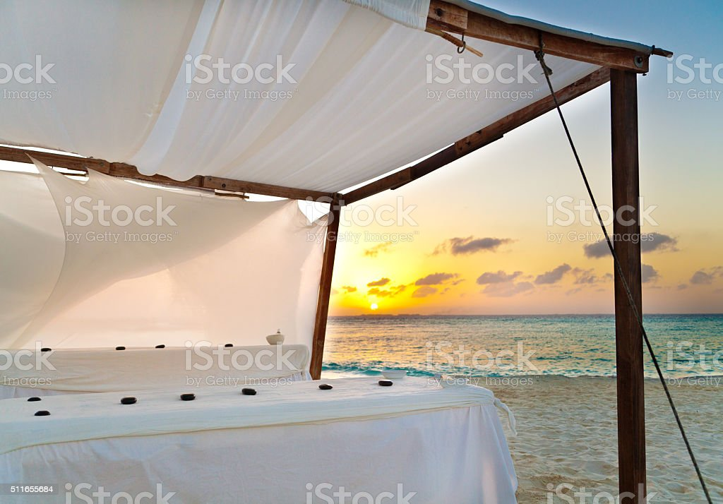 Outdoor Beach Massage Service at Sunset stock photo