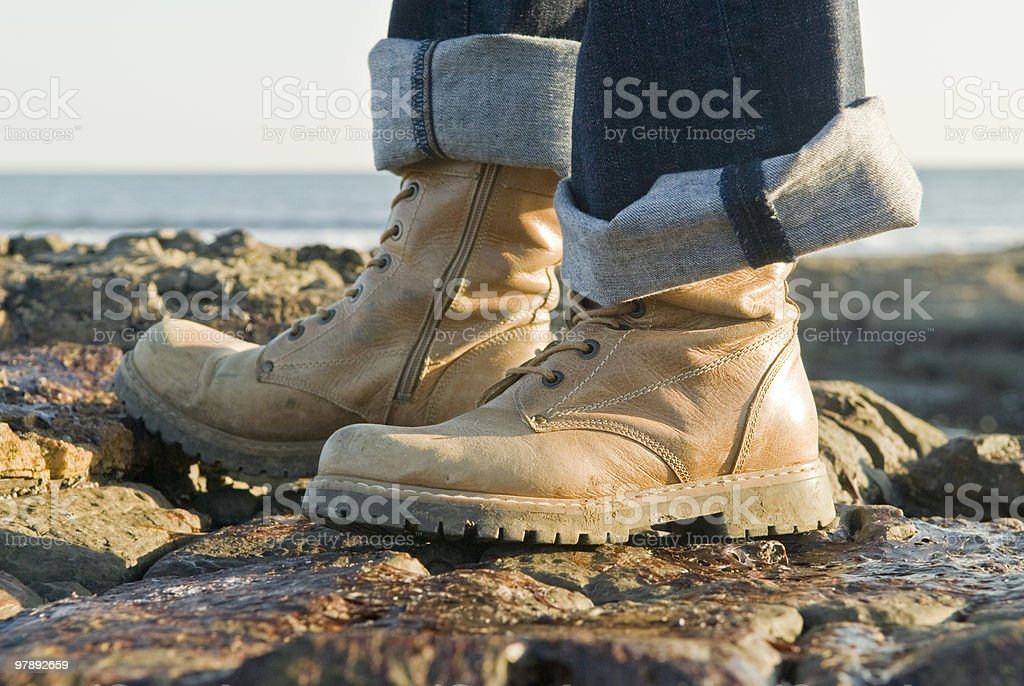 outdoor boots standing on rocks royalty-free stock photo