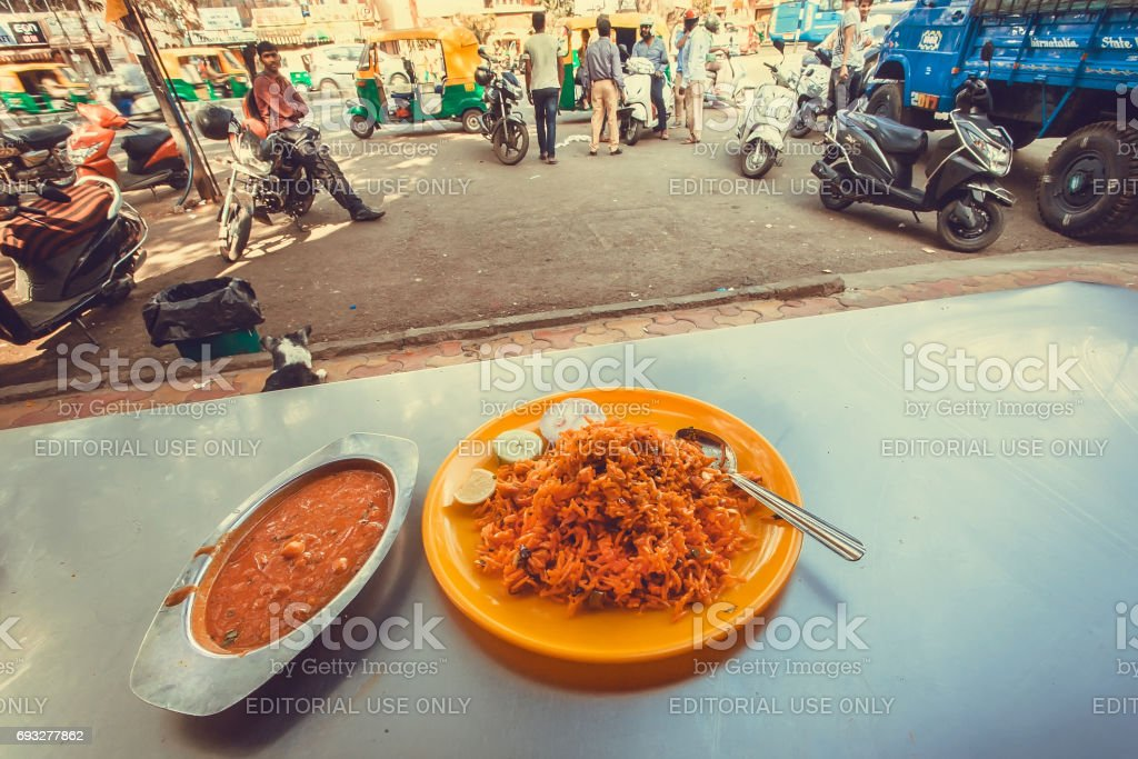 Outdoor cafe with indian vegeterian food biryani and lentil daal stock photo