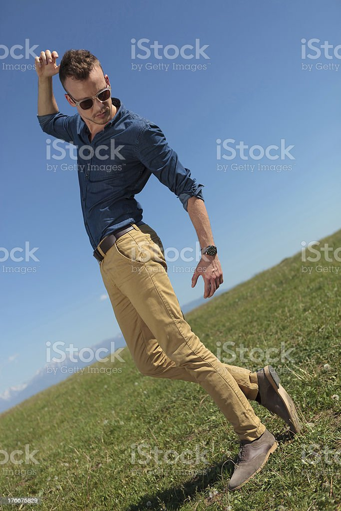 outdoor casual man looks down royalty-free stock photo