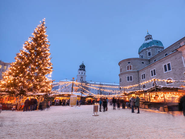 "Outdoor Christmas Market in Europe The famous ""Weihnachtsmarkt"" (Christmas Market) in Salzburg Austria. davelongmedia stock pictures, royalty-free photos & images"