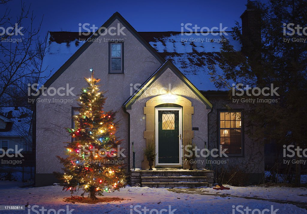 Outdoor Christmas Tree Decorated with Lights in Front of Home royalty-free stock photo