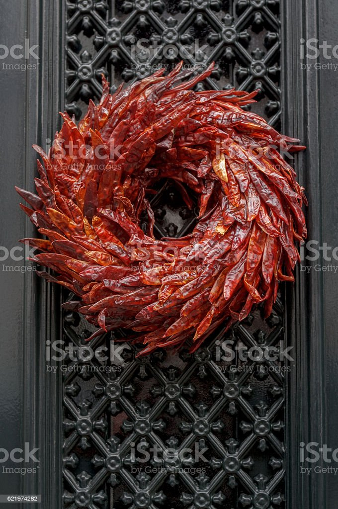 Outdoor Christmas wreath made of dried red hot chili peppers stock photo