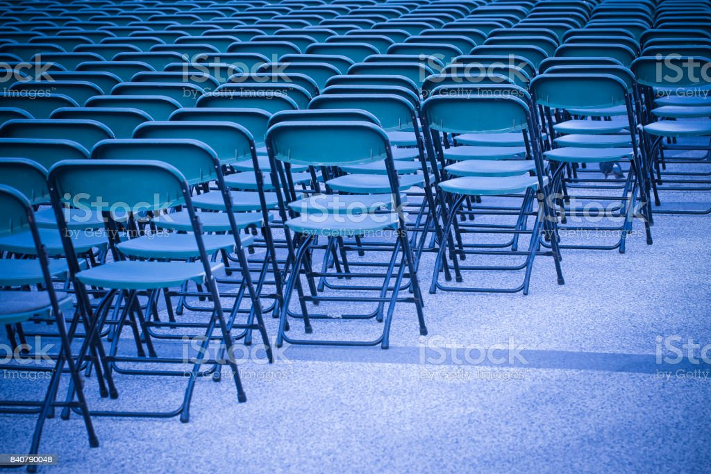 Outdoor cinema with plastic chairs - image with copy space stock photo